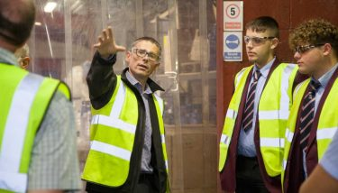 Dan Fox showing Holy Family Catholic School pupils Airedale Chemical's facilities during Bradford Manufacturing Week.