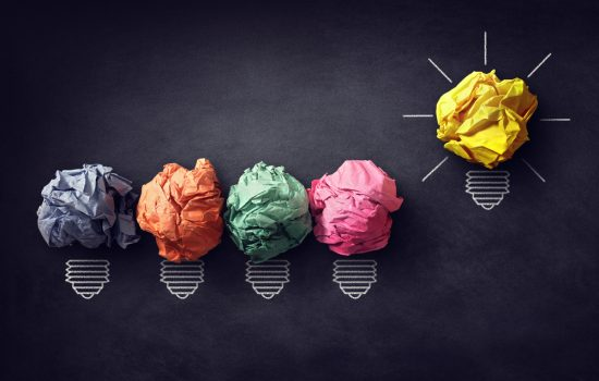 Good idea concept crumpled paper ball lightbulb on blackboard - creativity design thinking innovation - image courtesy of Depositphotos.