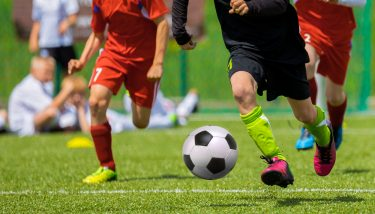 Traditionally, football data generated is collected only on players who have the ball - image courtesy of Depositphotos.