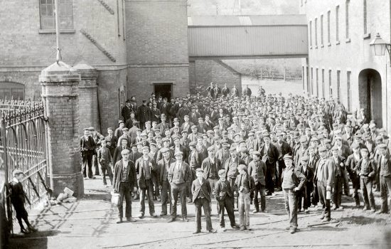 The Coalbrookdale Company once ran the largest ironworks in the world, employing over 3000 men and boys. Here, company workers are pictured on pay day.