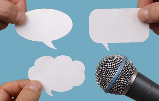 Blank speech bubbles with microphone interview opinion - image courtesy of Depositphotos.