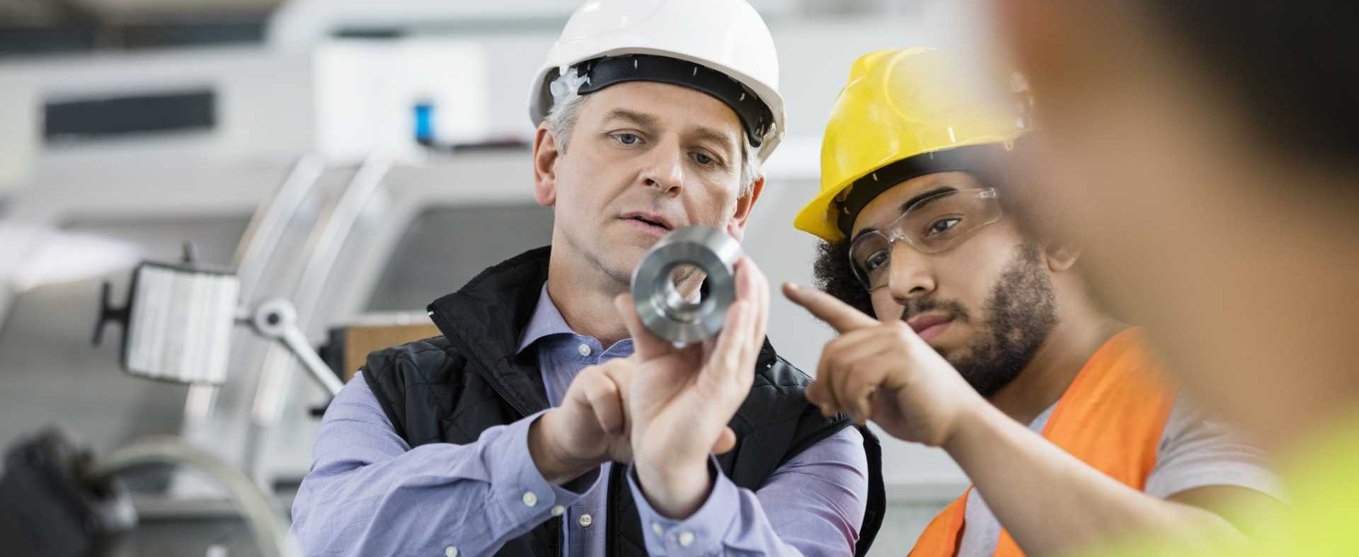 Supervisor and manual worker discussing in industry manufacturing engineering product quality - image courtesy of Depositphotos.