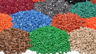 Dyed plastic granulate recycling - image courtesy of Depositphotos.