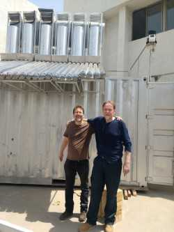 Solar-Polar's Michael Reid and Robert Edwards with the innovative system following installation on a rooftop in Ahmadabad - image courtesy of Solar-Polar.