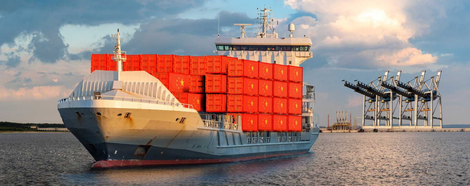 Container ship at sea carrying containers with flag of China - import export zero tariffs - supply chain - image courtesy of Depositphotos.
