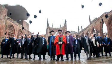 Carl Perrin (centre) is pictured with recent graduates from AME - image courtesy of AME.