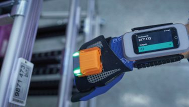 BMW Supply Chain - Scanners mounted on gloves, or within smartphones, transmit comprehensive parts data without the need for paper – image courtesy of BMW Group.