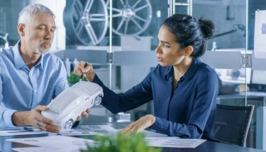 Experienced Automotive Designer and Female Engineer Works with a Concept Car Model Prototype Design Team Work People Innovation Stock - image courtesy of Depositphotos.