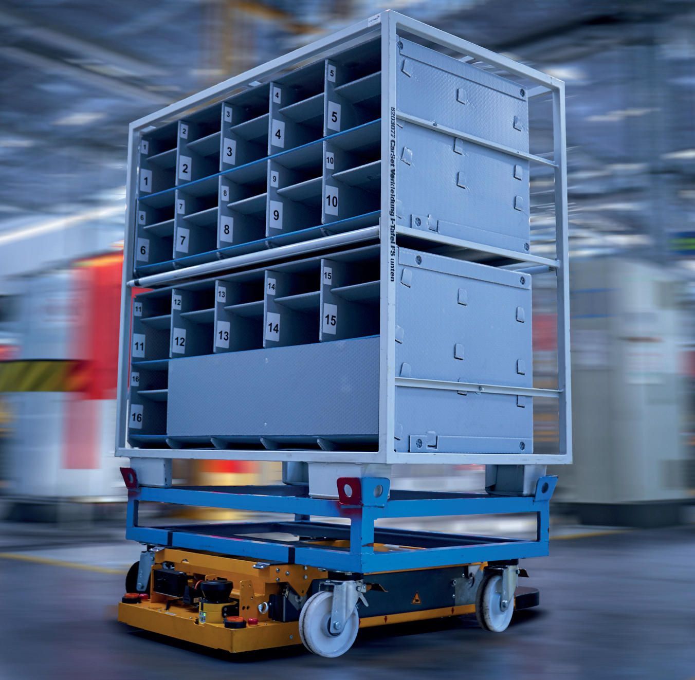 BMW Supply Chain - Smart Transport Robots (STRs) use their hydraulic platform to lift parts trollies off the floor and move them to where they need to be - image courtesy of BMW Group.
