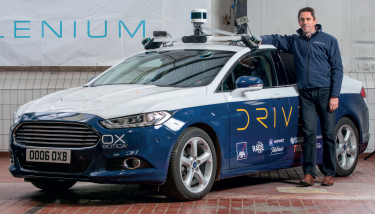 Oxbotica's CEO Graeme Smith with their autonomous vehicles in Oxford