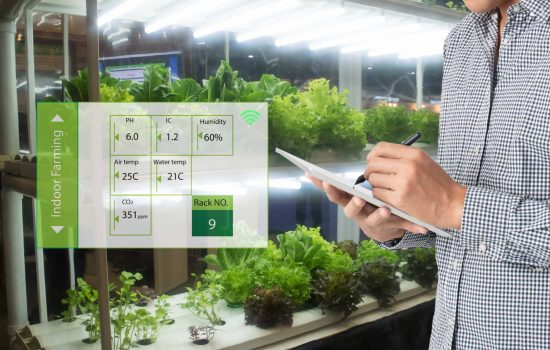 Smart agriculture in futuristic concept, farmer use technology - image courtesy of Depositphotos.