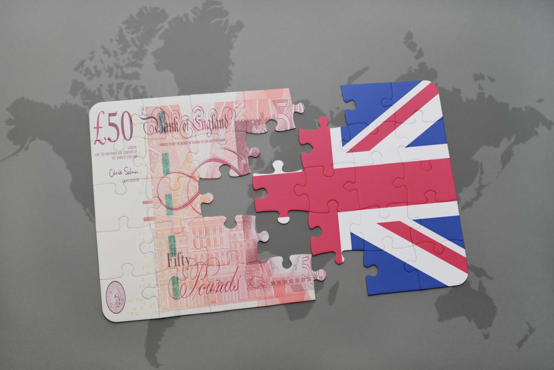 National Investment Bank for Britain - Puzzle with the national flag of great britain and british pound on a world map background - image courtesy of Depositphotos. annual-investment-allowance