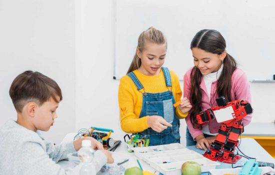 Everyday engineering - Schoolchildren Programming Robot Together Stem Educational Class - image courtesy of Depositphotos.