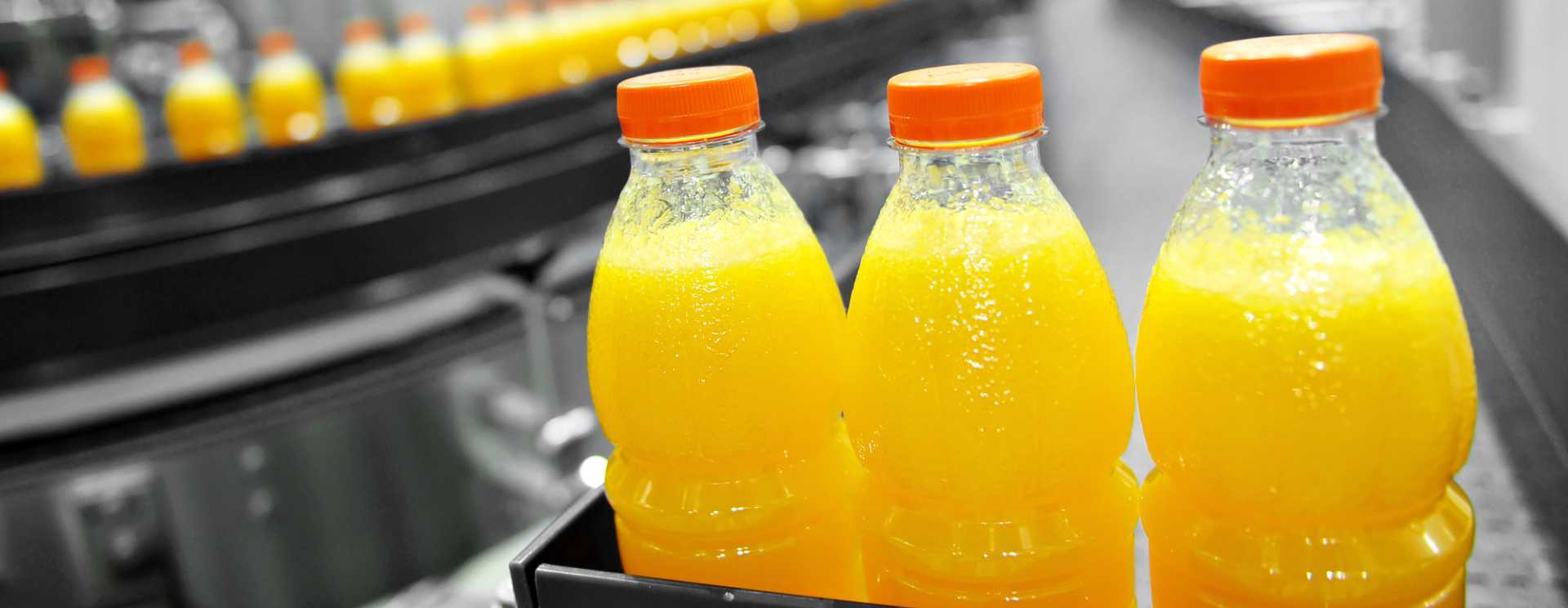 CROP - Orange Juice Factory - image courtesy of Depositphotos.