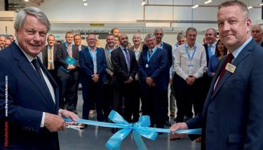 Terry Allison (R) and Paul Dupee (executive chairman) cutting the ribbon at the opening of the new factory.