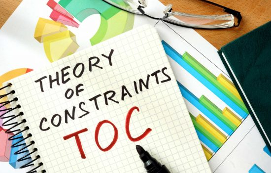 Words Theory of Constraints TOC on the notepad and charts - image courtesy of Depositphotos.