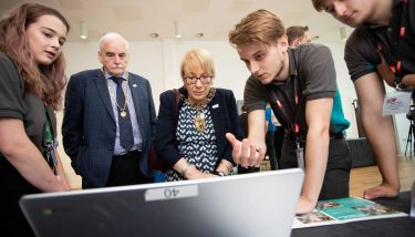 Team Prodigies explain its working and concept to Lord Mayor of Coventry, Linda Bigham.