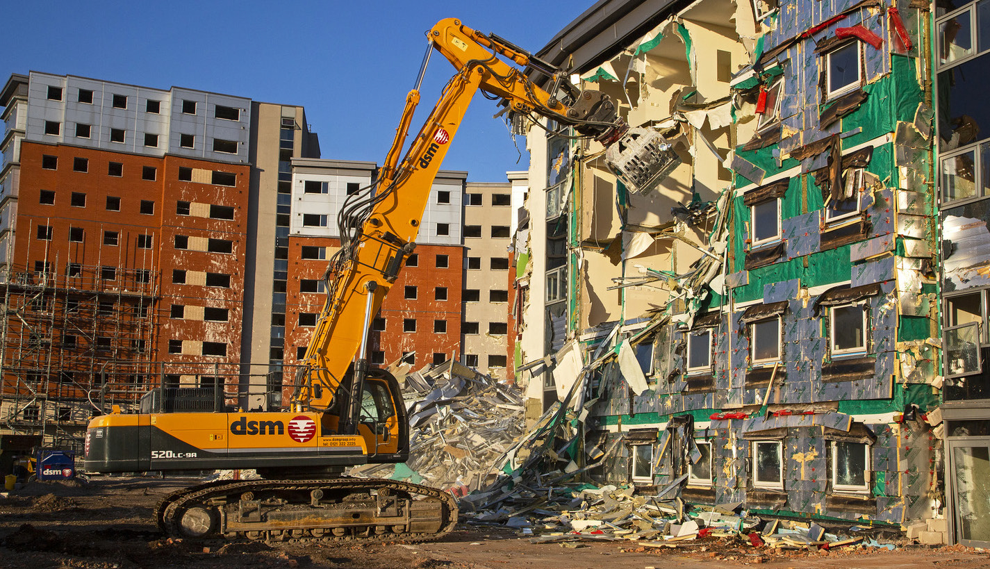 During the demolition of former students' hall of residence, a new way had to be found to safely break up and recycle the materials used during its construction. Birmingham demolitions company DSM developed a technique that releases each student 'pod' and lifts them down so they can be broken up at ground level.