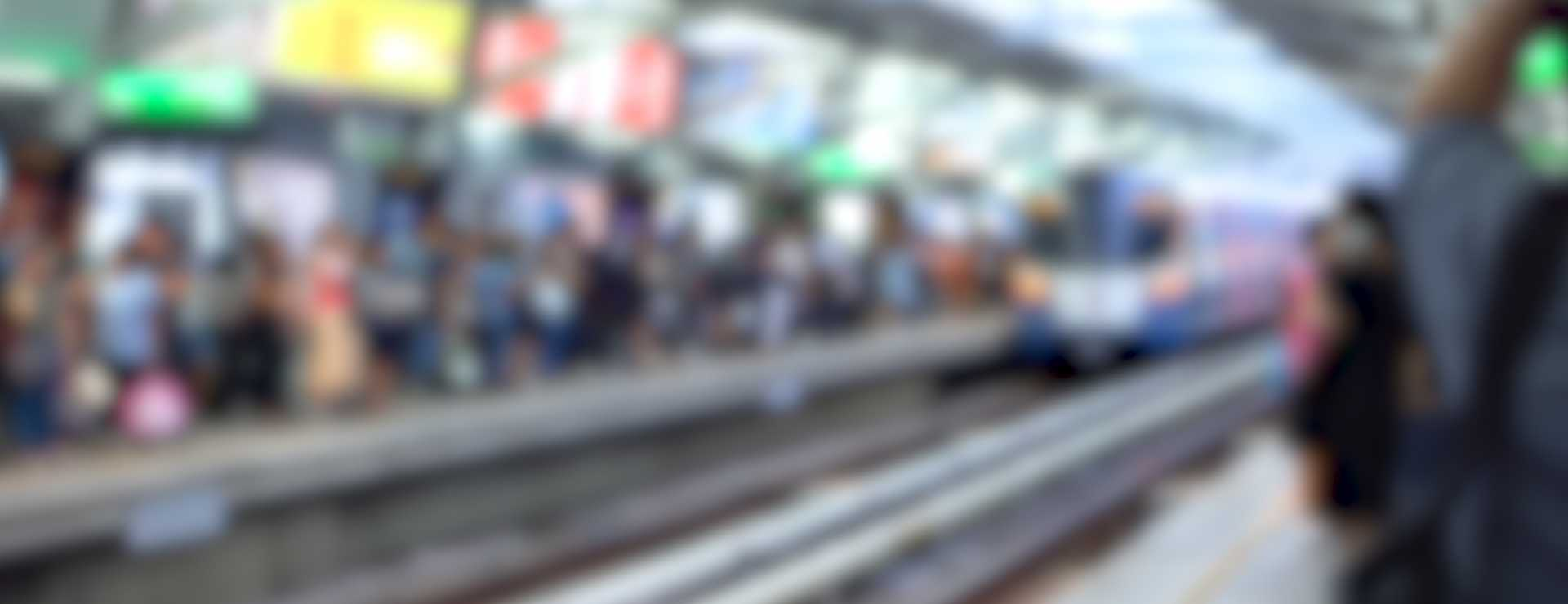 Out of Focus - Crowd of Commuters Waiting For Train - image courtesy of Depositphotos.