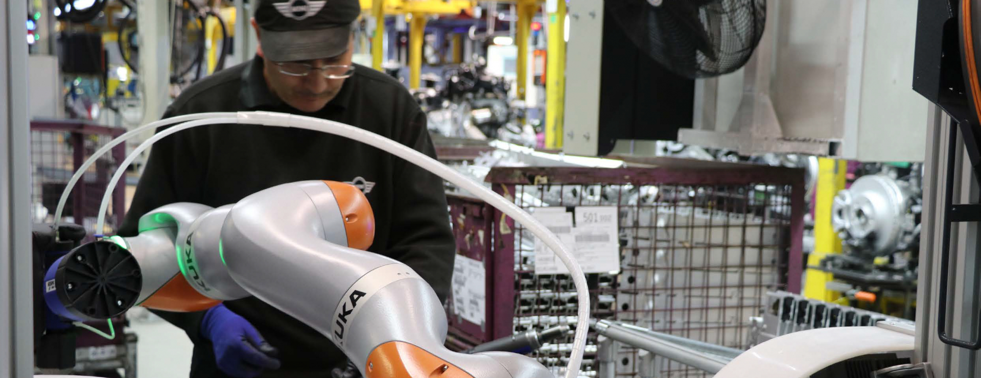 CROP - RITA on the MINI Plant Oxford production line, helping to assemble components for the car's crumple zone pre-assembly - image courtesy of BMW Group MINI.