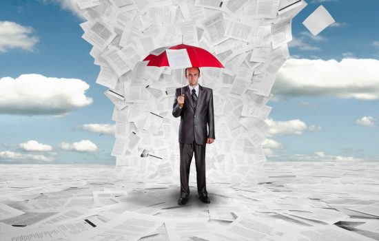 Businessman with red umbrella under huge wave of documents - document management - paper - image courtesy of Depositphotos.