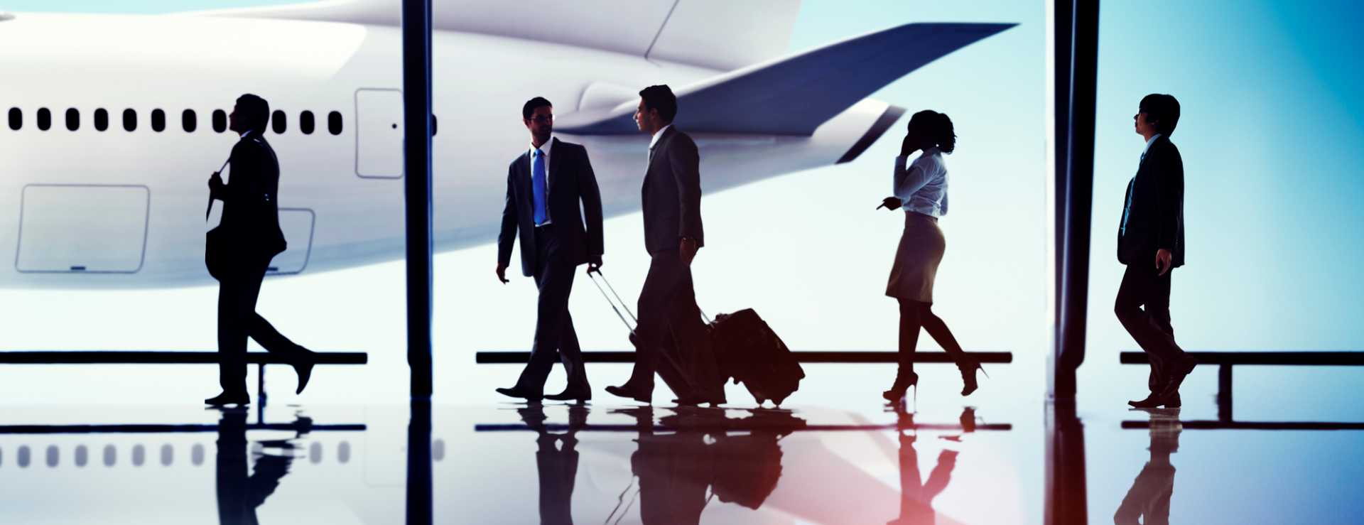 Silhouettes of Business People Travel Aviation - image courtesy of Depositphotos.