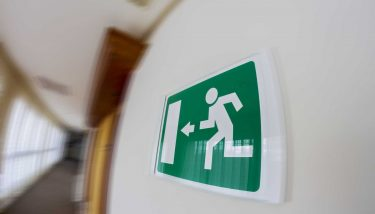 Fire Escape Route Evacuation Health and Safety - image courtesy of Depositphotos.