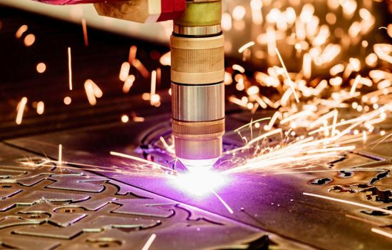 UK SMEs CNC Laser plasma cutting of metal, modern industrial technology - image courtesy of Depositphotos.