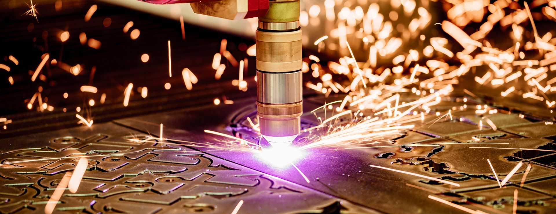 UK SMEs CNC Laser plasma cutting of metal, modern industrial technology - image courtesy of Depositphotos.