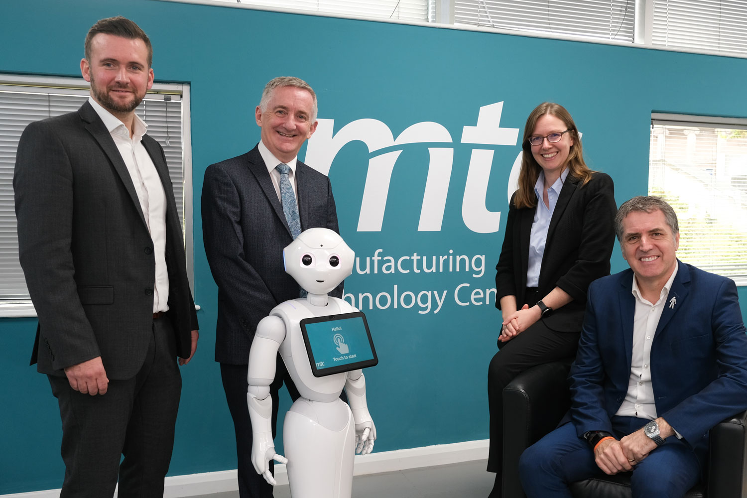 Charlie Whitford, associate director for strategic development (MTC); Jonathon Shaw, director of technical resources (MTC); Pepper the humanoid robot; Hannah Edmonds, technical specialist (MTC); and Metro Mayor of the Liverpool City Region, Steve Rotheram.