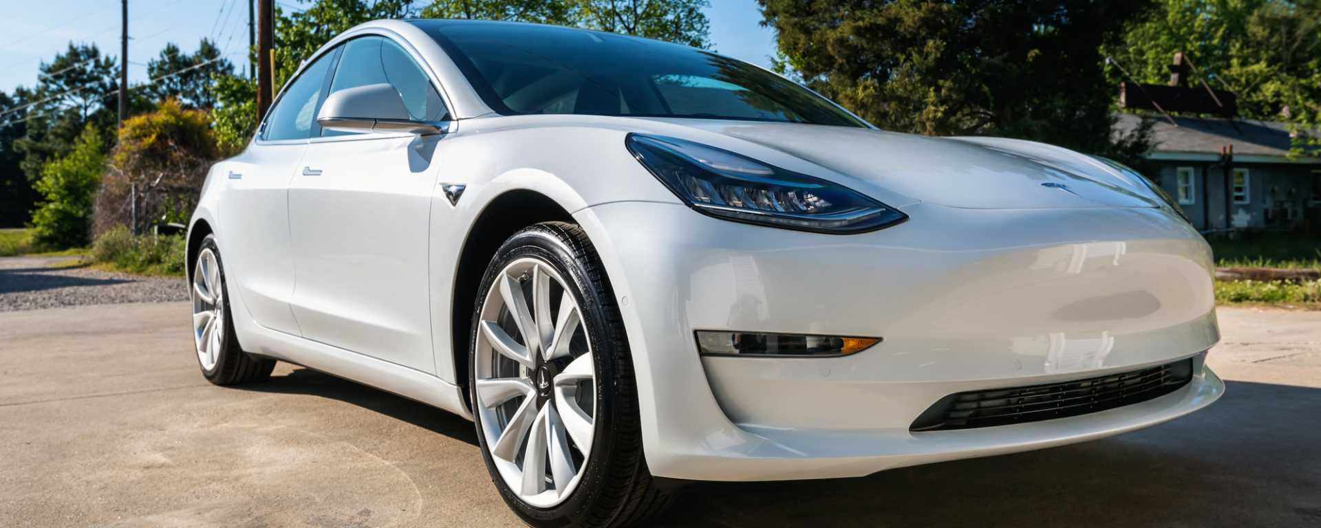 A brand new white Tesla Model 3 - image courtesy of Depositphotos.