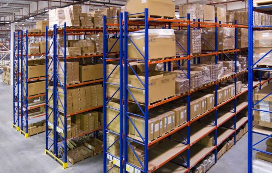Warehouse racking with shelves and boxes - image courtesy of Depositphotos.