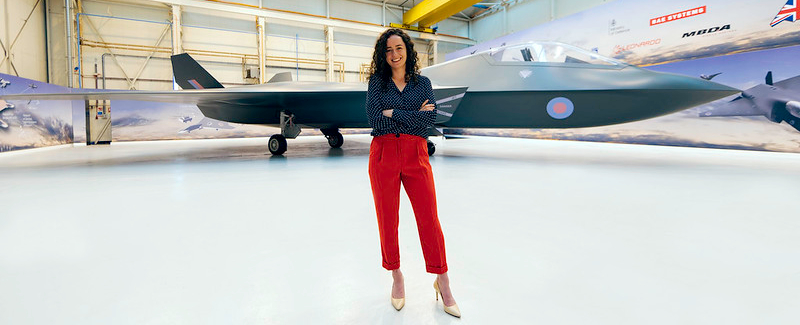 Female aerospace engineer in hangar with the Tempest aircraft - Photo: Harry Parvin - image courtesy of This is Engineering.
