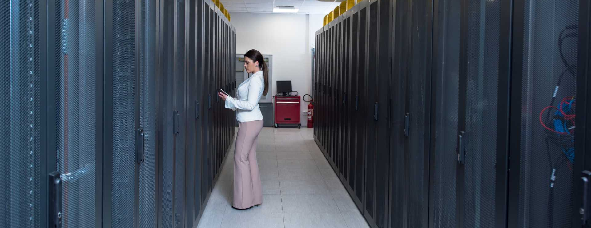 CROP - Female engineer working on a tablet computer in server room– image courtesy of Depositphotos.