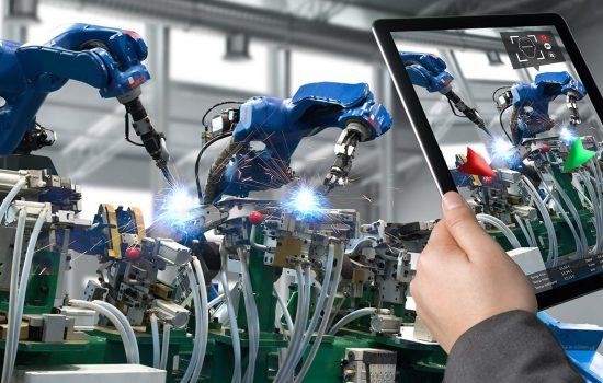 Connected Worker - Industrial 4.0 , Augmented reality concept. Hand holding tablet with AR service , maintenance application and calling technician for check destroy part of smart machine in smart factory background - STOCK IMAGE