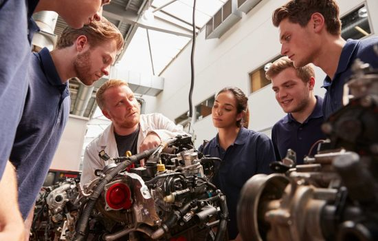 Mechanic showing engines to apprentices