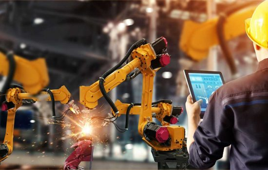 IoT Connectivity Investment in Automation - robots in factory Image: Shutterstock