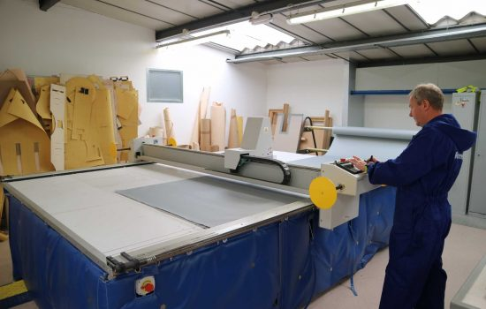 Powertherm - Mike Taylor (Flexible Products Division Manager) operating the Eastman CNC ply-cutting machine - courtesy of AMRC.