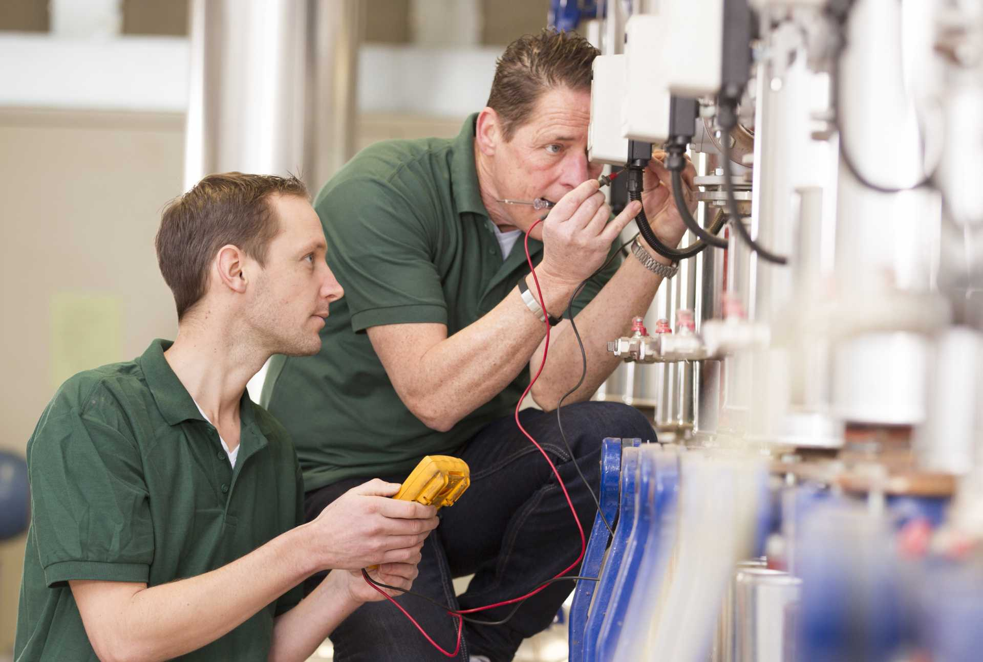 National Skills Task Force - Senior technician and junior technician repairing agriculture machinery in a greenhouse - shutterstock_258342233 (1)