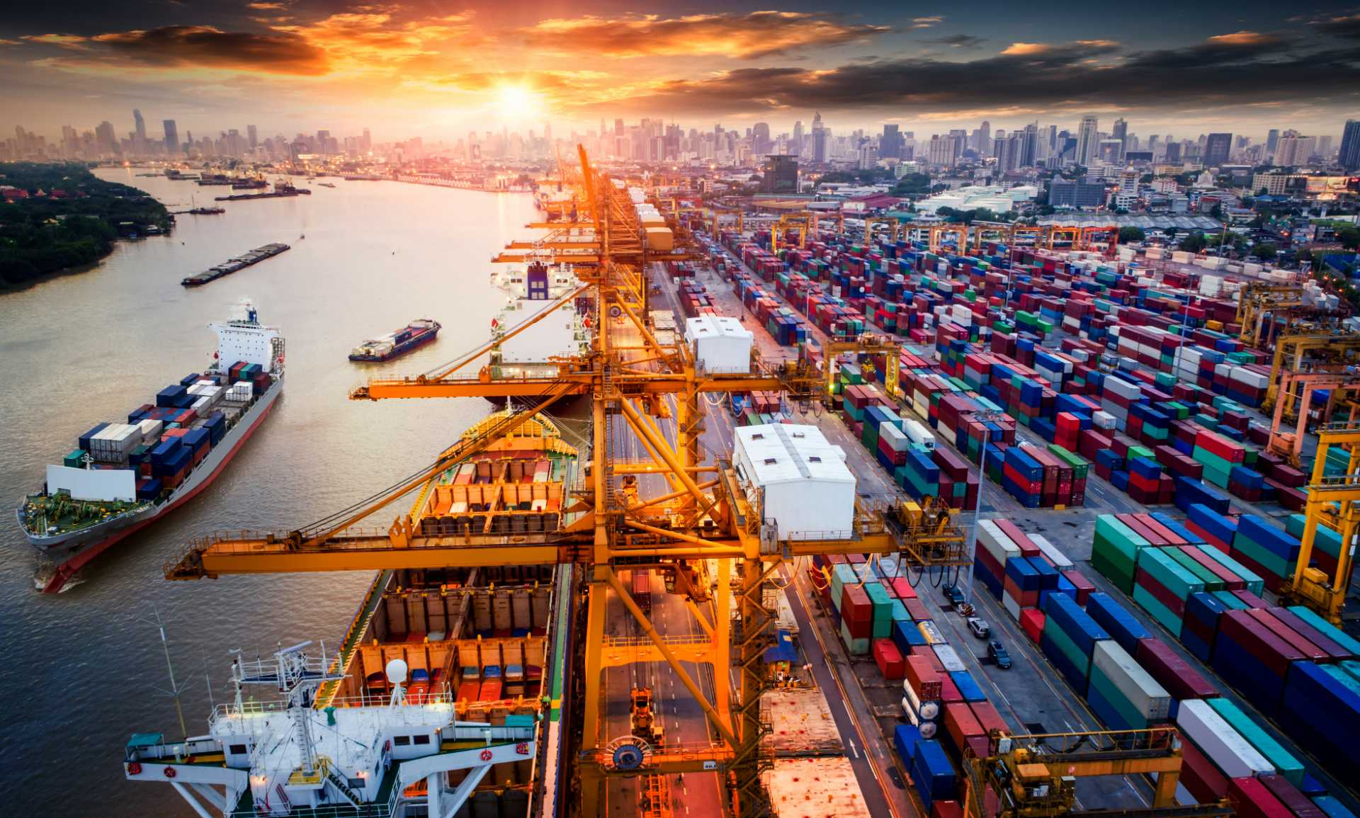 supply chain transparency - Logistics and transportation of Container Cargo ship and Cargo plane with working crane bridge in shipyard at sunrise, logistic import export and transport industry background - image courtesy of Shutterstock