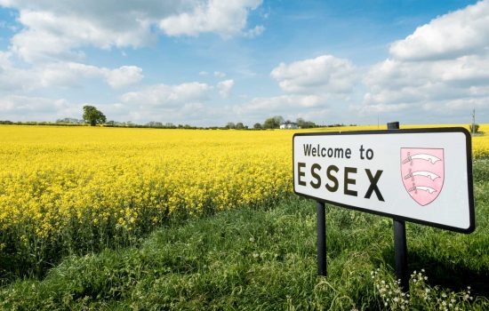 Welcome to Essex sign, UK. A rural English countryside scene on a bright spring day with a sign welcoming travellers to the English county of Essex. Shutterstock