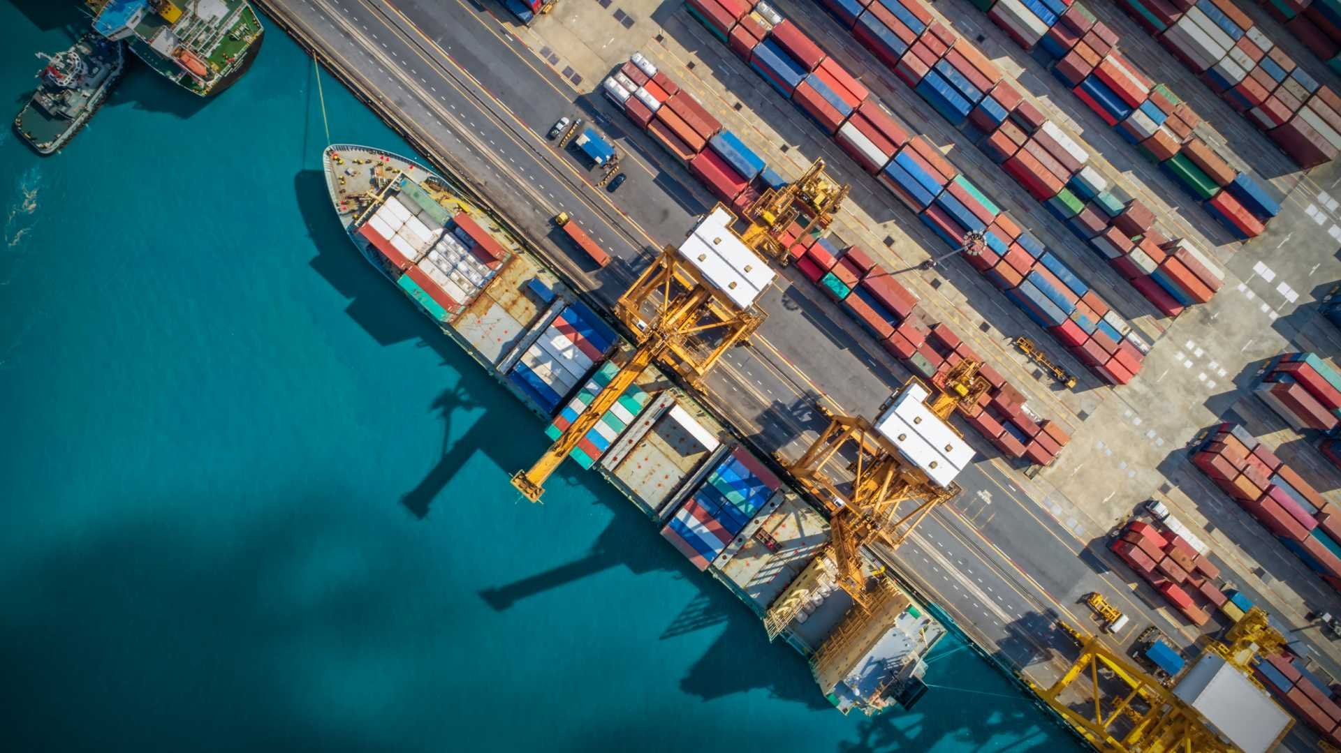 Shipping supply chain docks logistics containers port terminal - shutterstock_1094326709