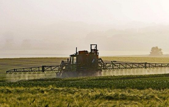 A crop being sprayed with a pesticide such as Roundup - Image by Erich Westendarp from Pixabay