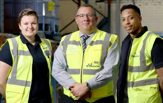 Captured at the launch of the very first Bradford Manufacturing Week in 2018 is Nick Garthwaite, founder of Bradford Manufacturing Weeks and Chair of West & North Yorkshire Chamber of Commerce with Christeyns apprentices Lauren Bean (L) and Jordan Smith (R).