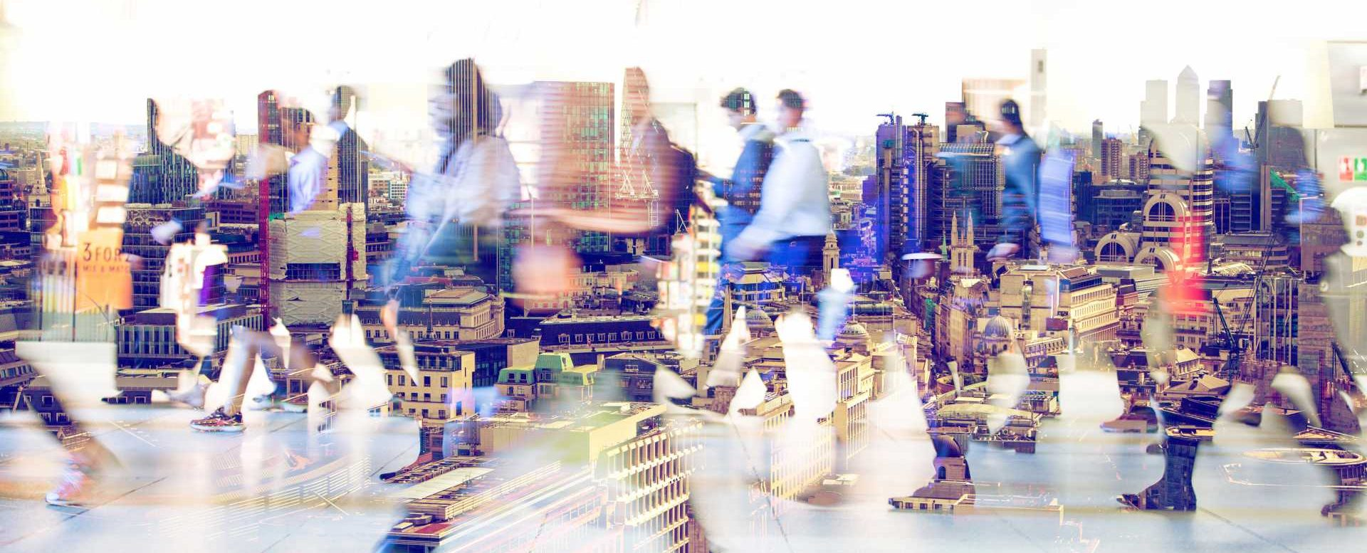 Silhouettes of walking people. Multiple exposure blurred image. Business concept illustration. - shutterstock_571977865
