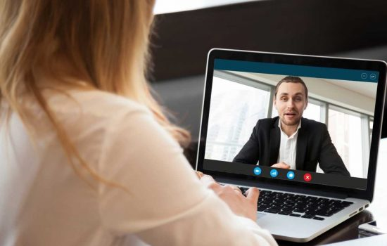 Video Interviews - Businesswoman making video call to business partner using laptop, looking at screen with virtual web chat, contacting client by conference, talking on webcam, online consultation, hr concept, close up - shutterstock_699442555