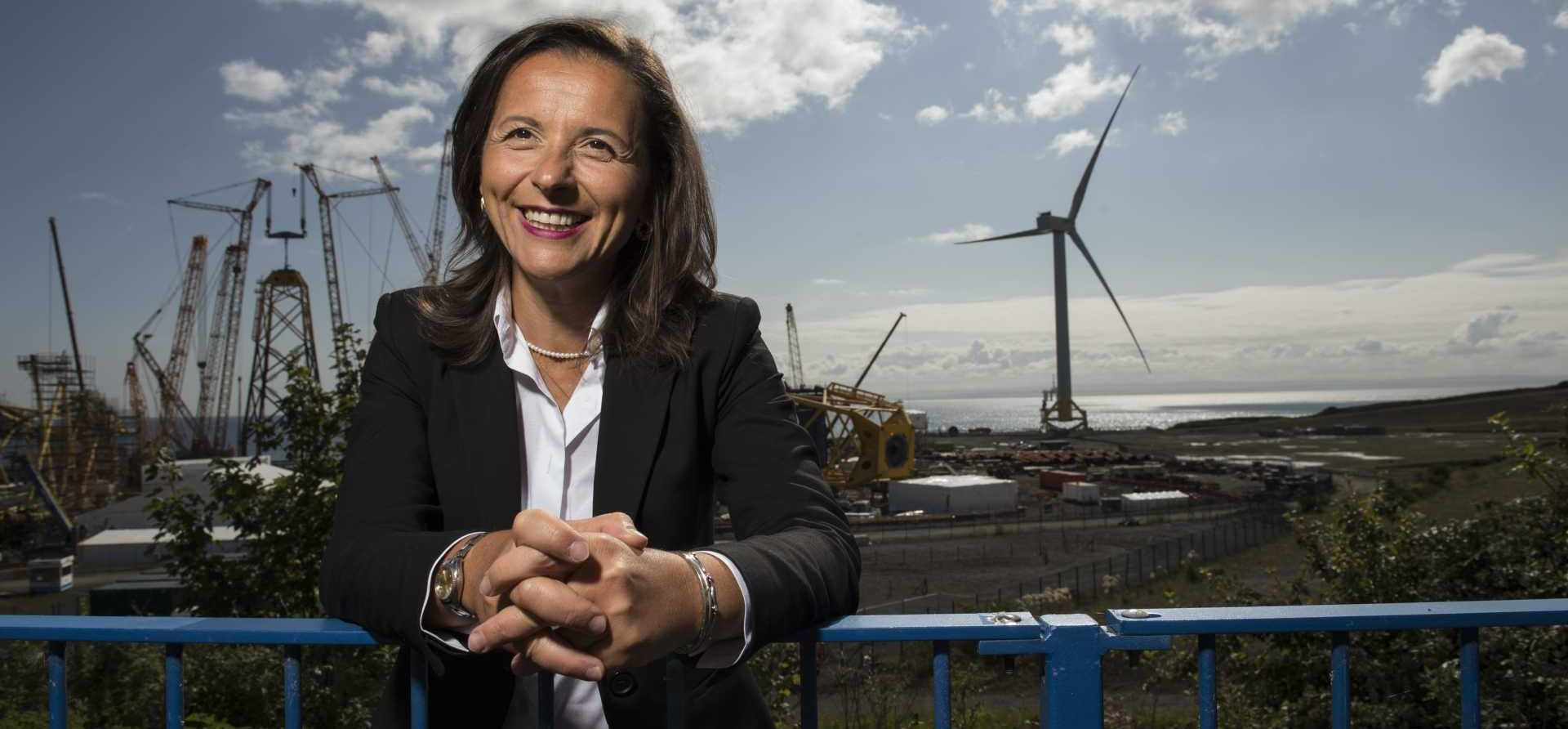 CEO Sabrina Malpede in front of wind farm in Edinburgh - © Wattie Cheung