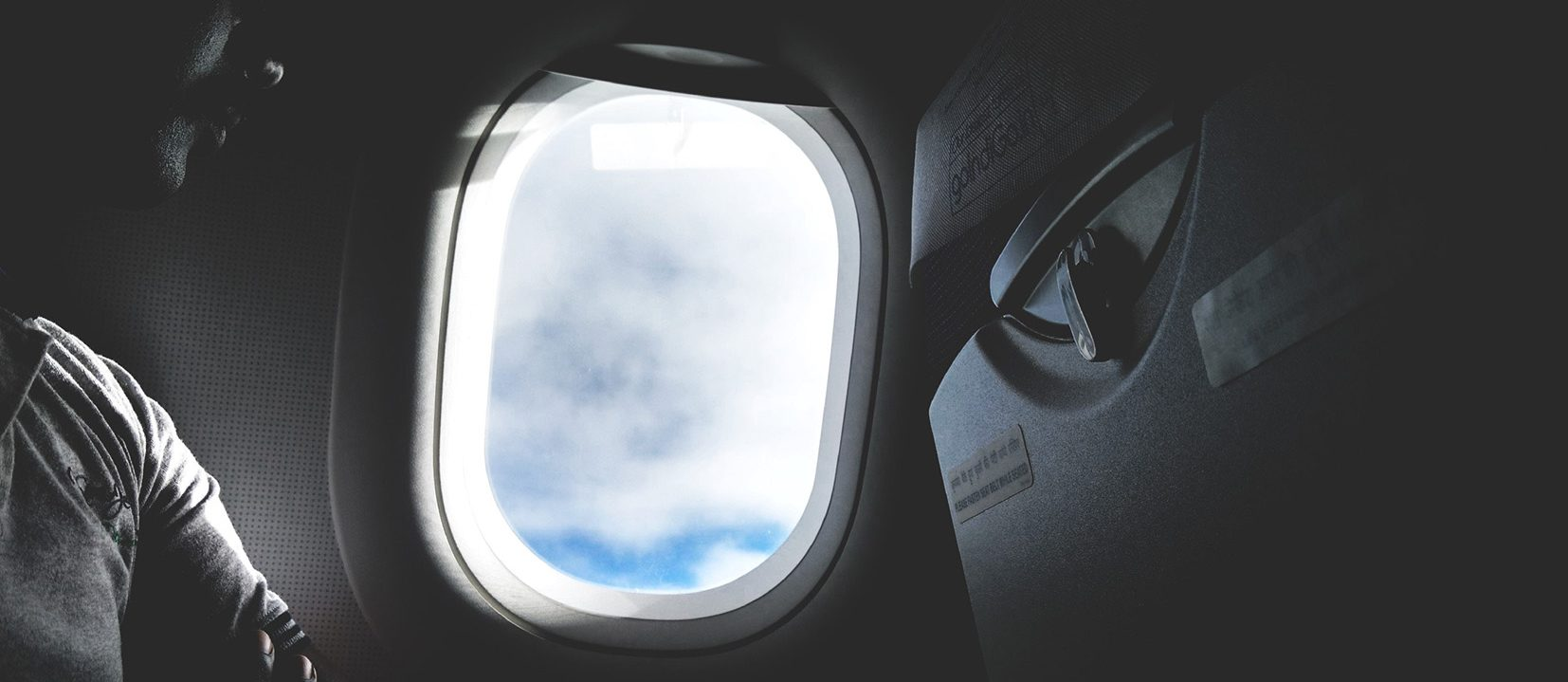 Airplane-window (Anugrah Lohiya) air passengers travel safely