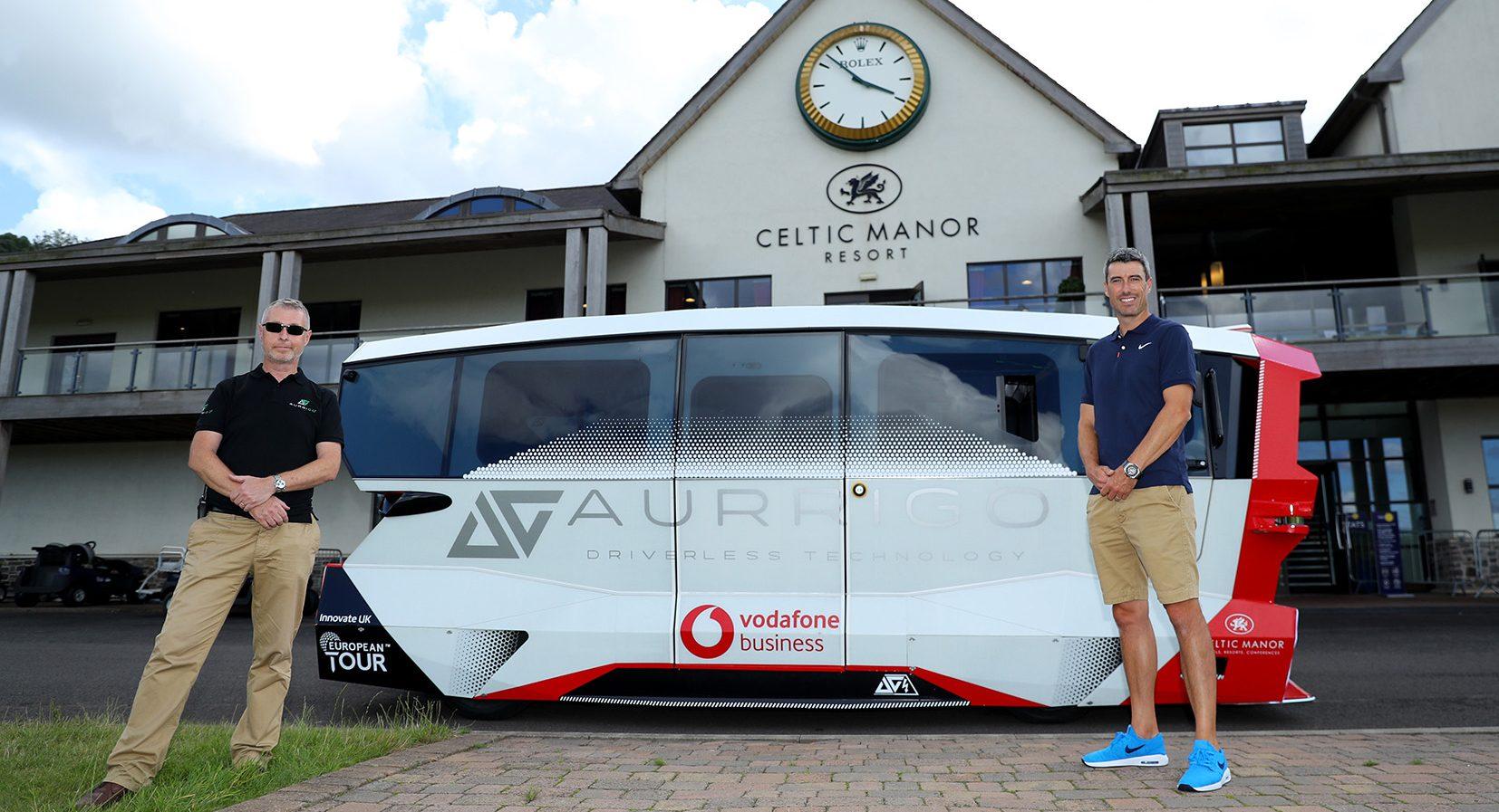 Aurrigo Autonomous Shuttle Celtic Manor - (L to R) Miles Garner (Aurrigo) with professional golfer Ross Fisher.