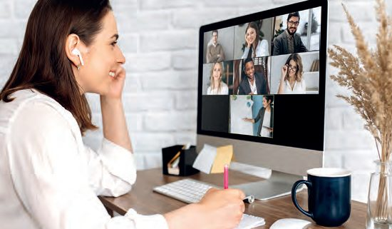 Video call. Remote work. A girl work from home. She communicate via video communication with colleagues using computer - Shutterstock